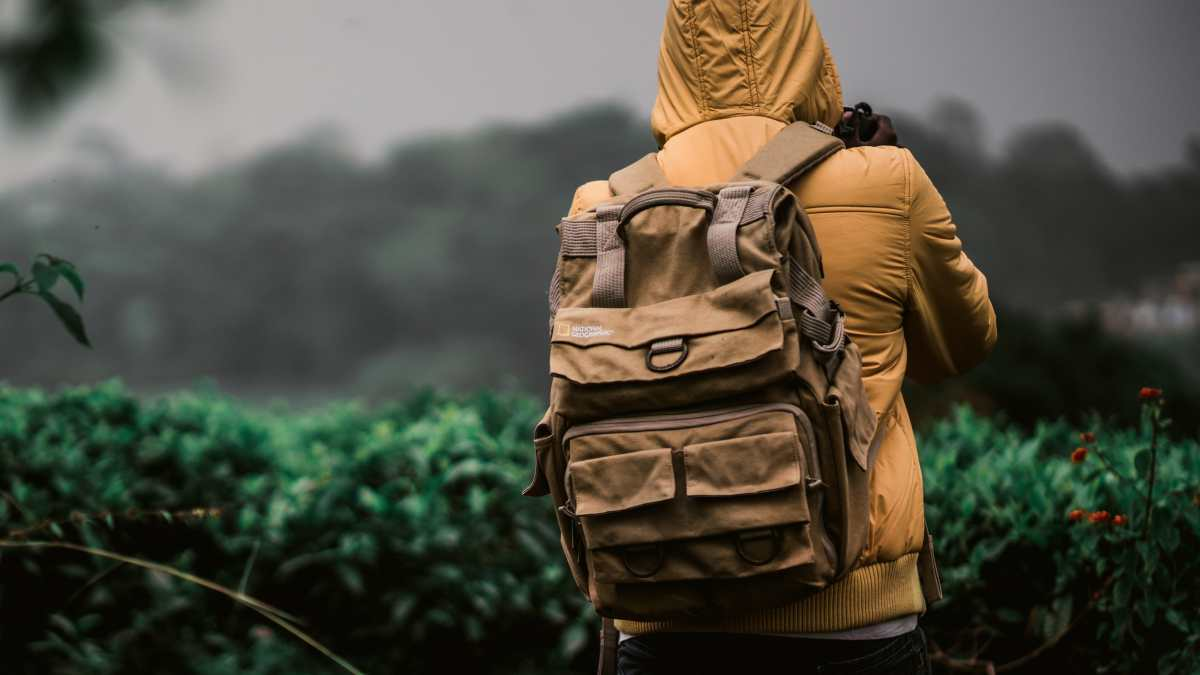 A boy with a bug out bag in the outdoor