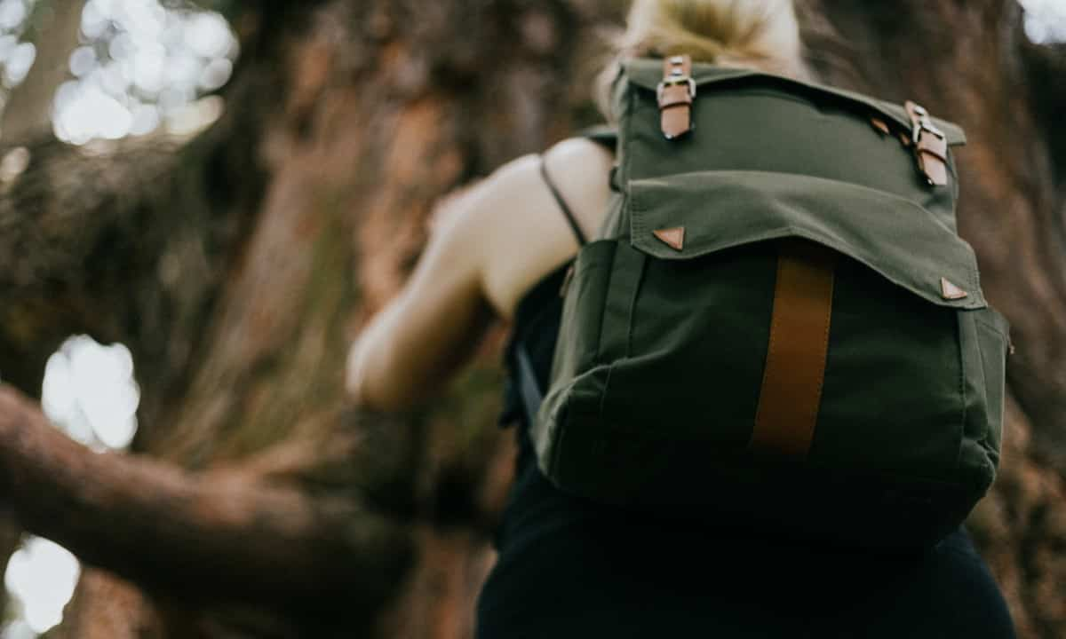 A women climbing with Sling Backpack