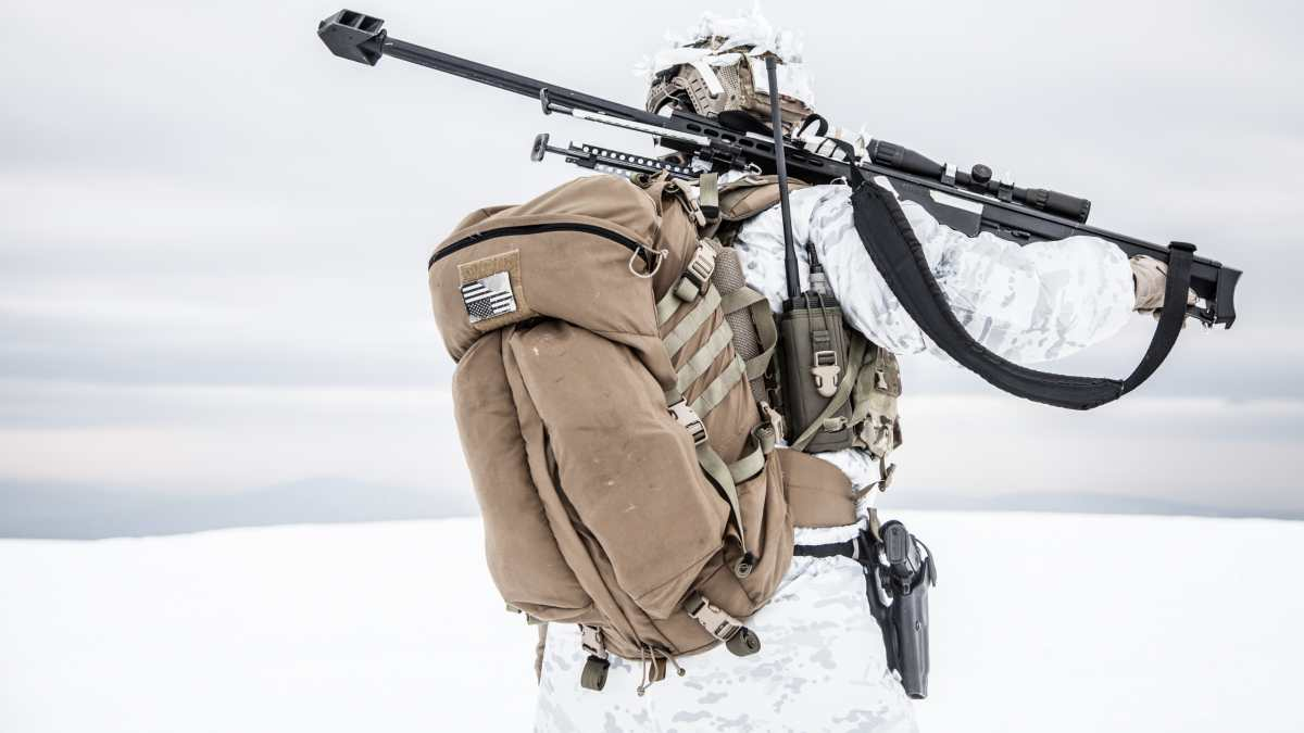 Soldier in Winter with tactical backpack